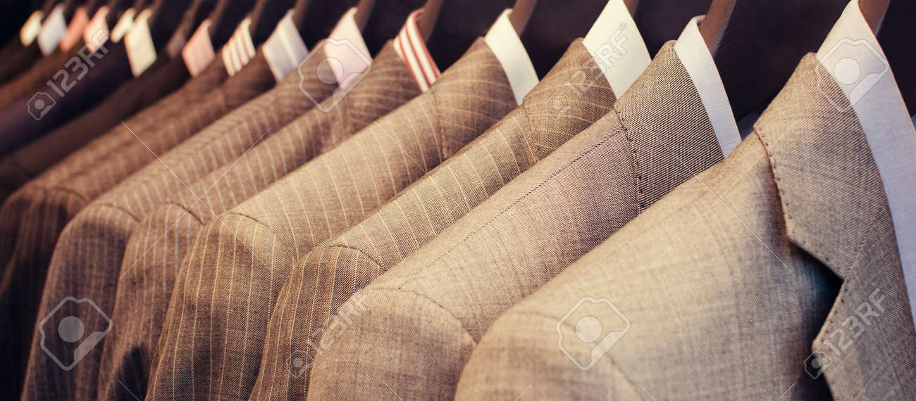Men suits hanging in a clothing store. - 45885358
