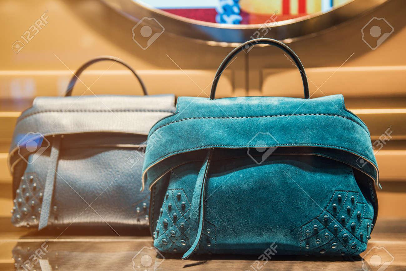 Women handbag in a luxury store - 66165764