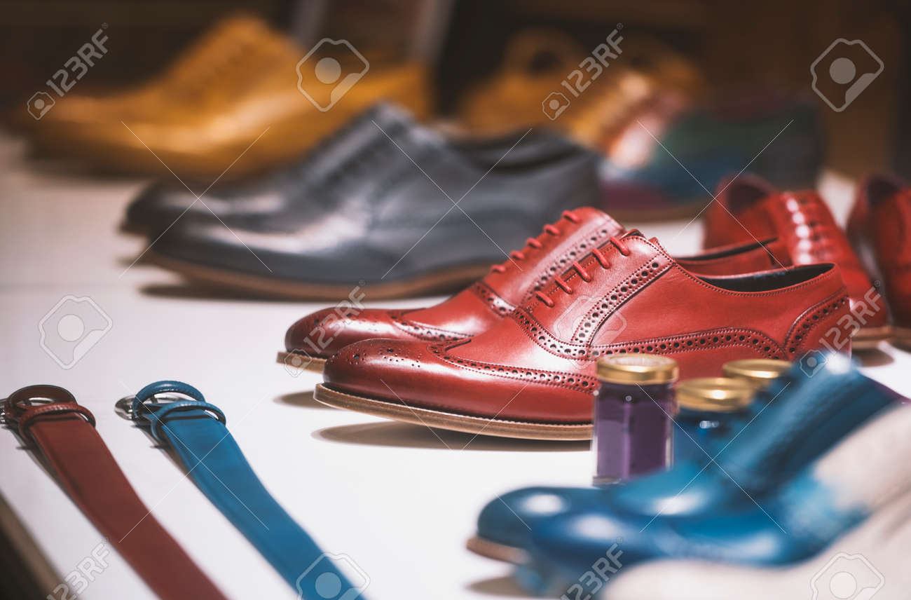 Fancy colorful shoes in a men clothing store. - 79175289