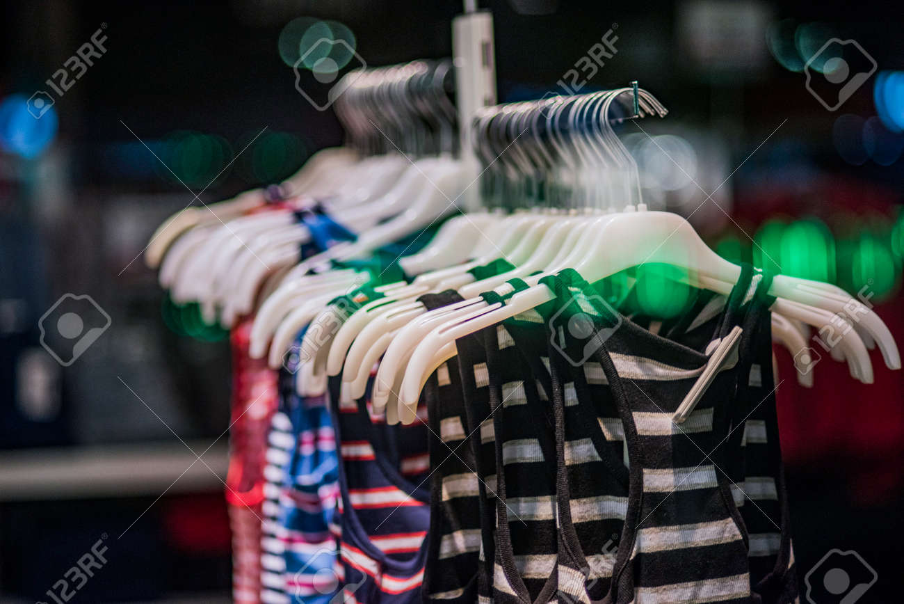 0712bb71e46 Fashionable clothes in a boutique store. Stock Photo - 80989694