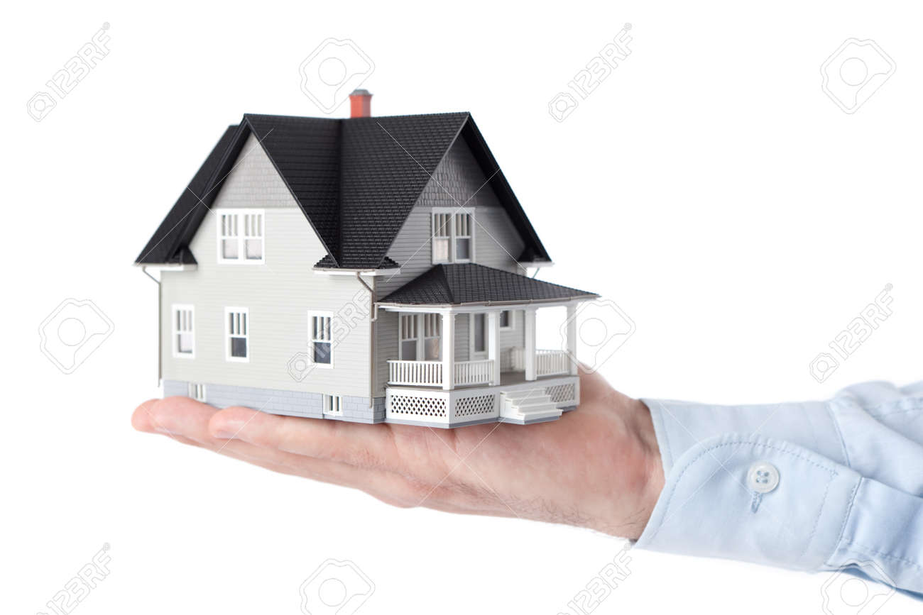 real estate concept hand holding house architectural model