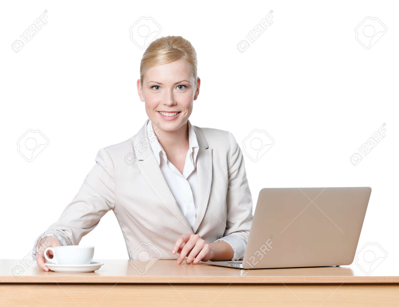Young businesswoman sitting at a desk with a cup of tea, isolated Stock Photo - 13894449