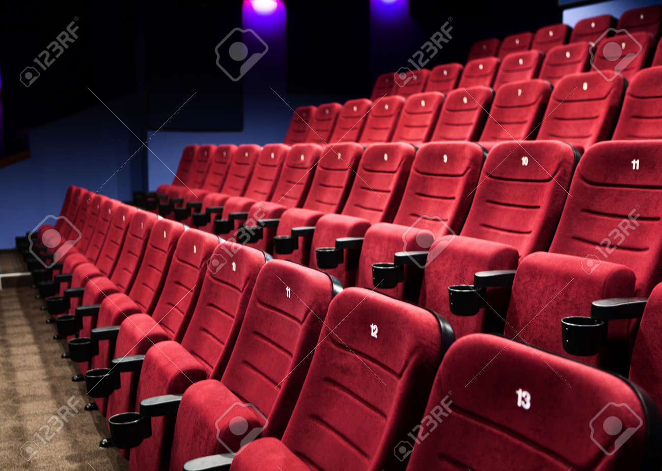 Empty rows of  red cinema seats Stock Photo - 13999817