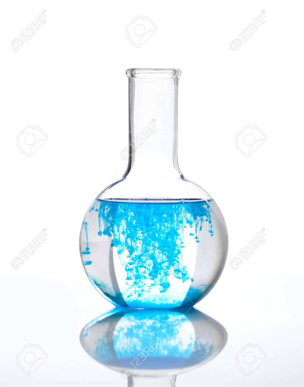 Chemical flask full of transparent liquid with a blue reagent, isolated Stock Photo - 13999794