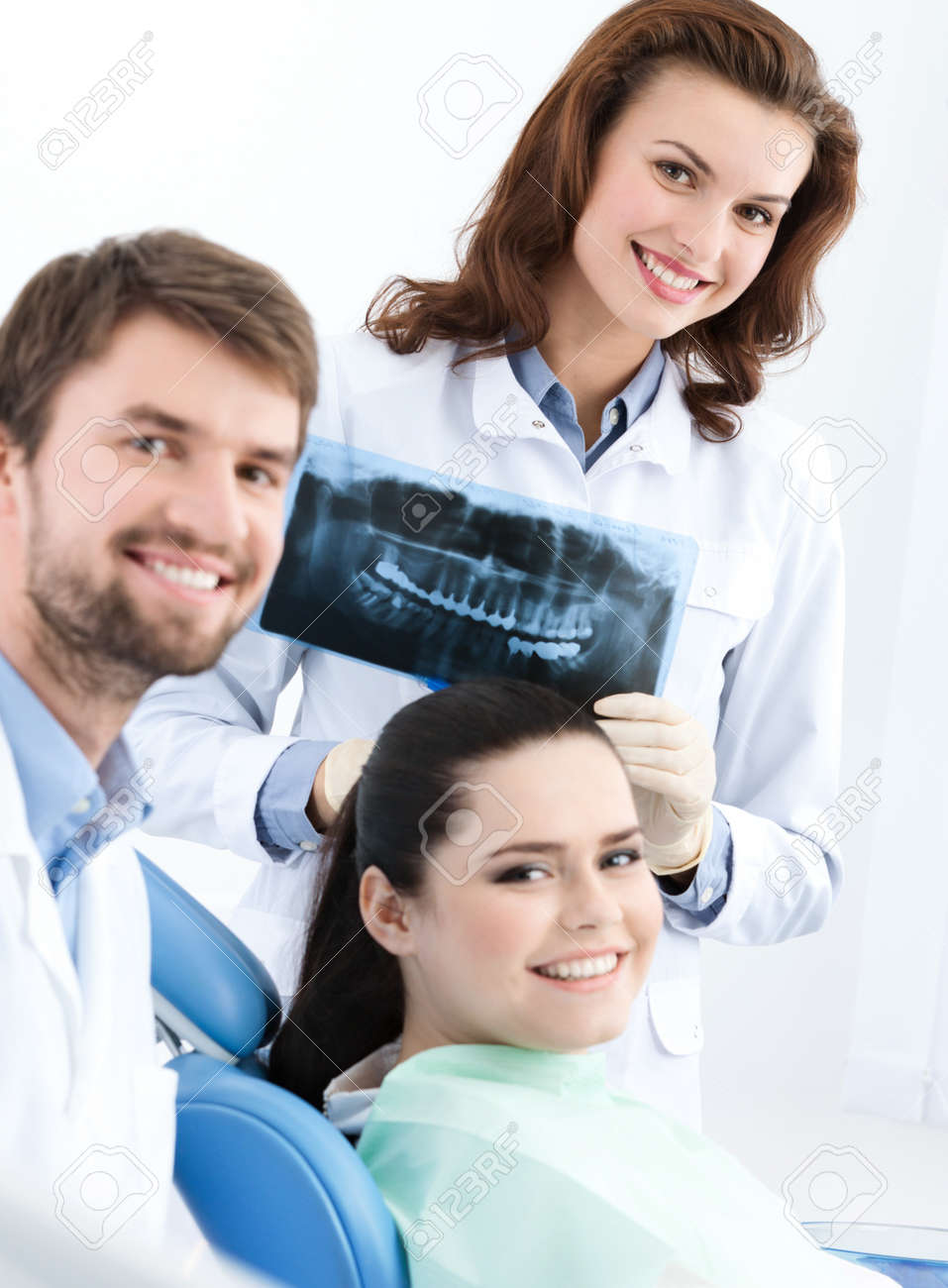 Dentist, assistant and client are satisfied of their work, close up Stock Photo - 14729942