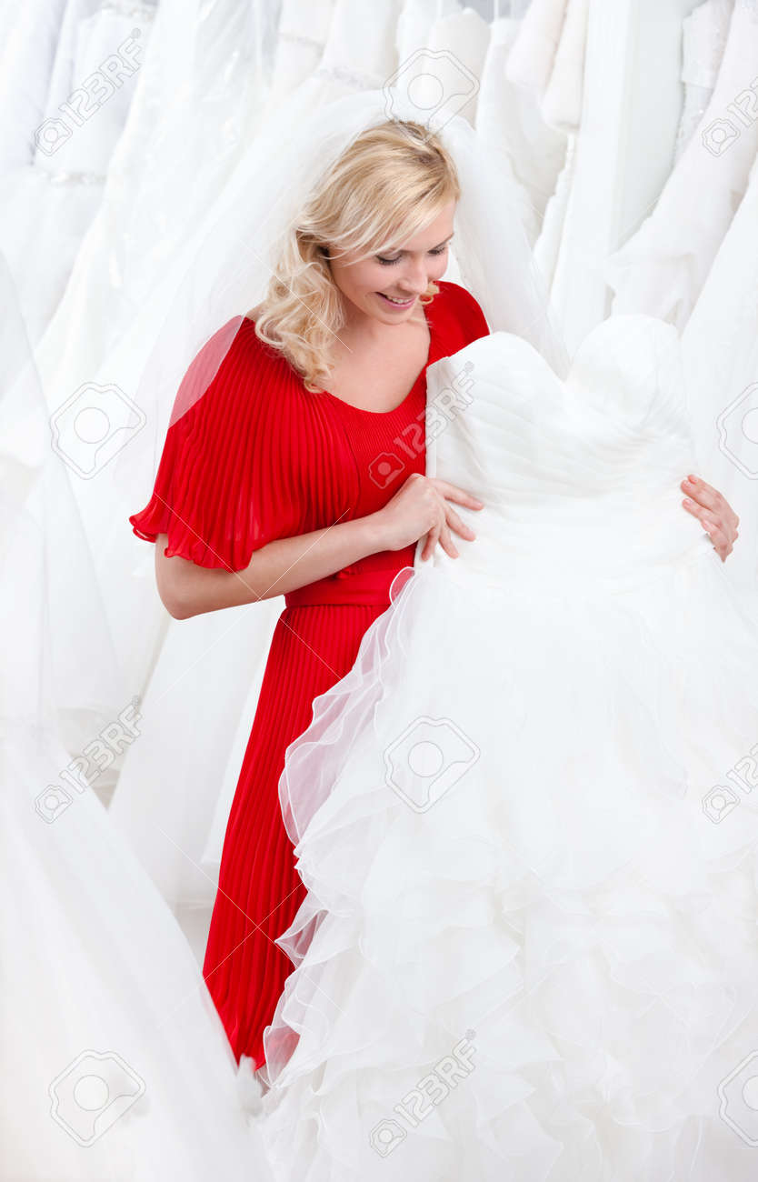 Future bride chooses an appropriate wedding gown Stock Photo - 14729997