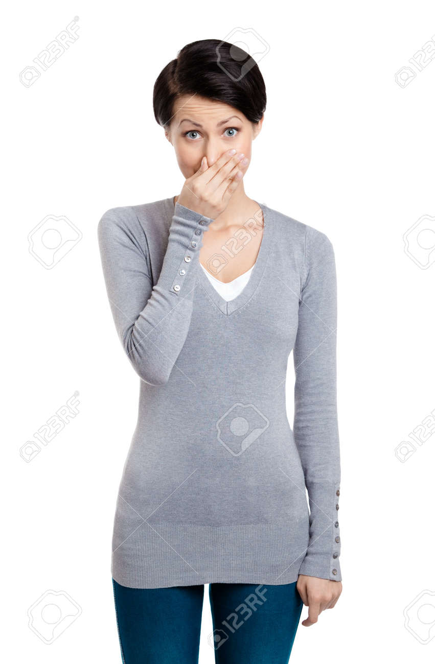 Young woman closes her nose with hand, isolated on white Stock Photo - 14847505