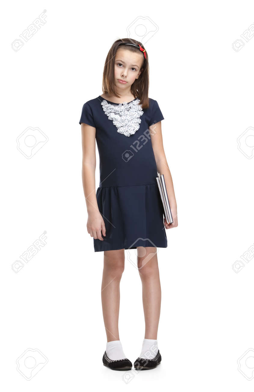 Sad schoolgirl carries her books, isolated, white background Stock Photo - 14980153