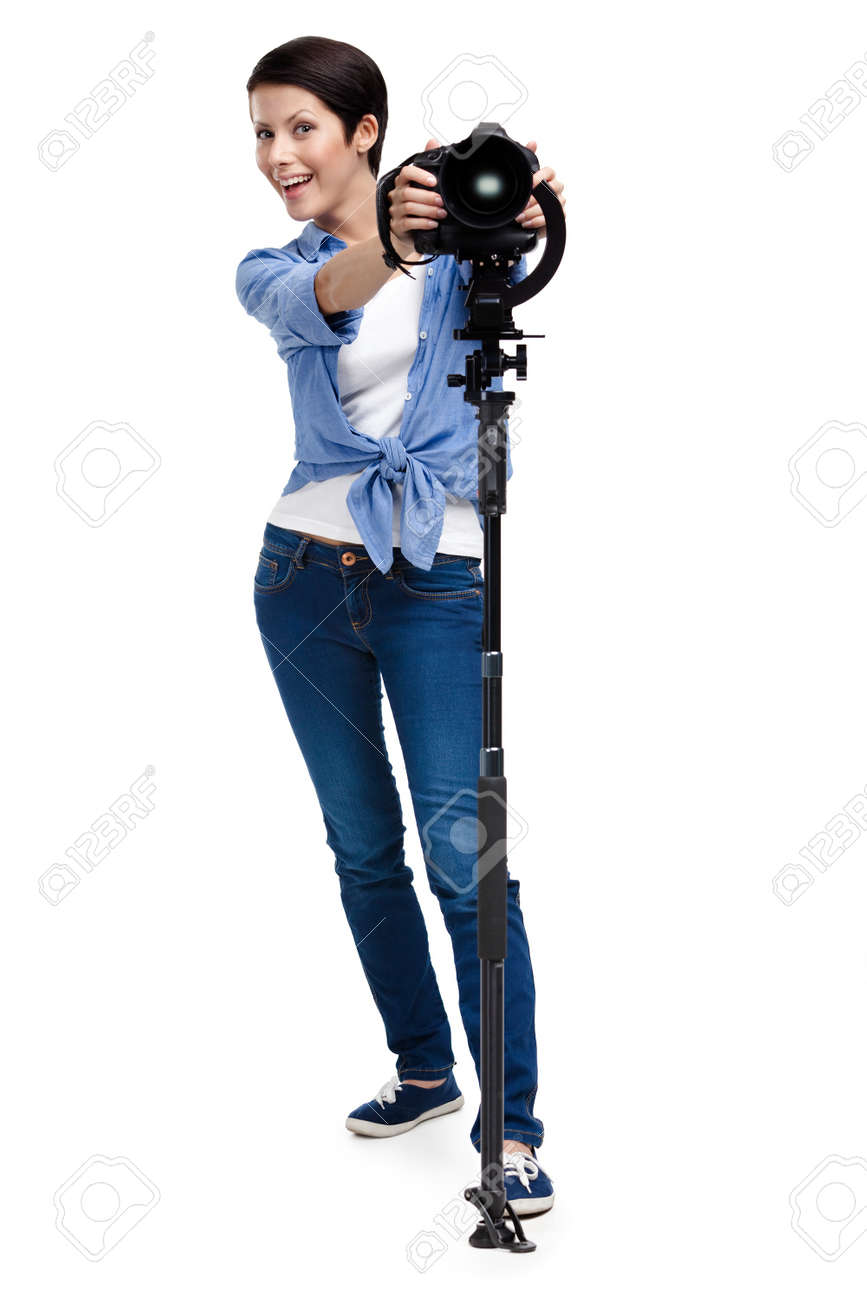 Woman is ready to take pictures holding photographic camera, isolated on white Stock Photo - 14980148