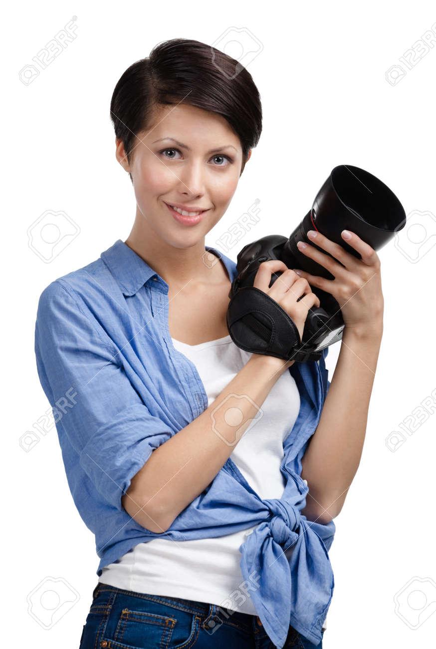 Girl takes images holding photographic camera, isolated on white Stock Photo - 14980353