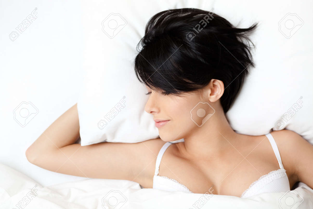 Sleeping sexy woman in the double bed, white background Stock Photo - 14996082