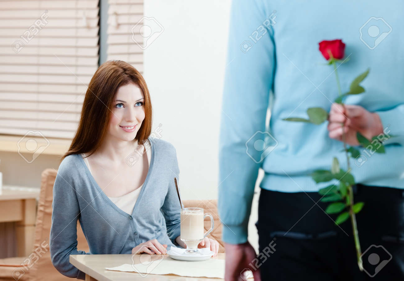 Man keeps crimson rose behind his back to present it to his girlfriend Stock Photo - 15044400