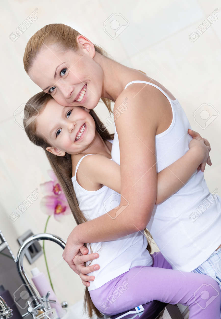 Mother And Daughter Hug Each Other In Bathroom Trust Relationship Stock Photo