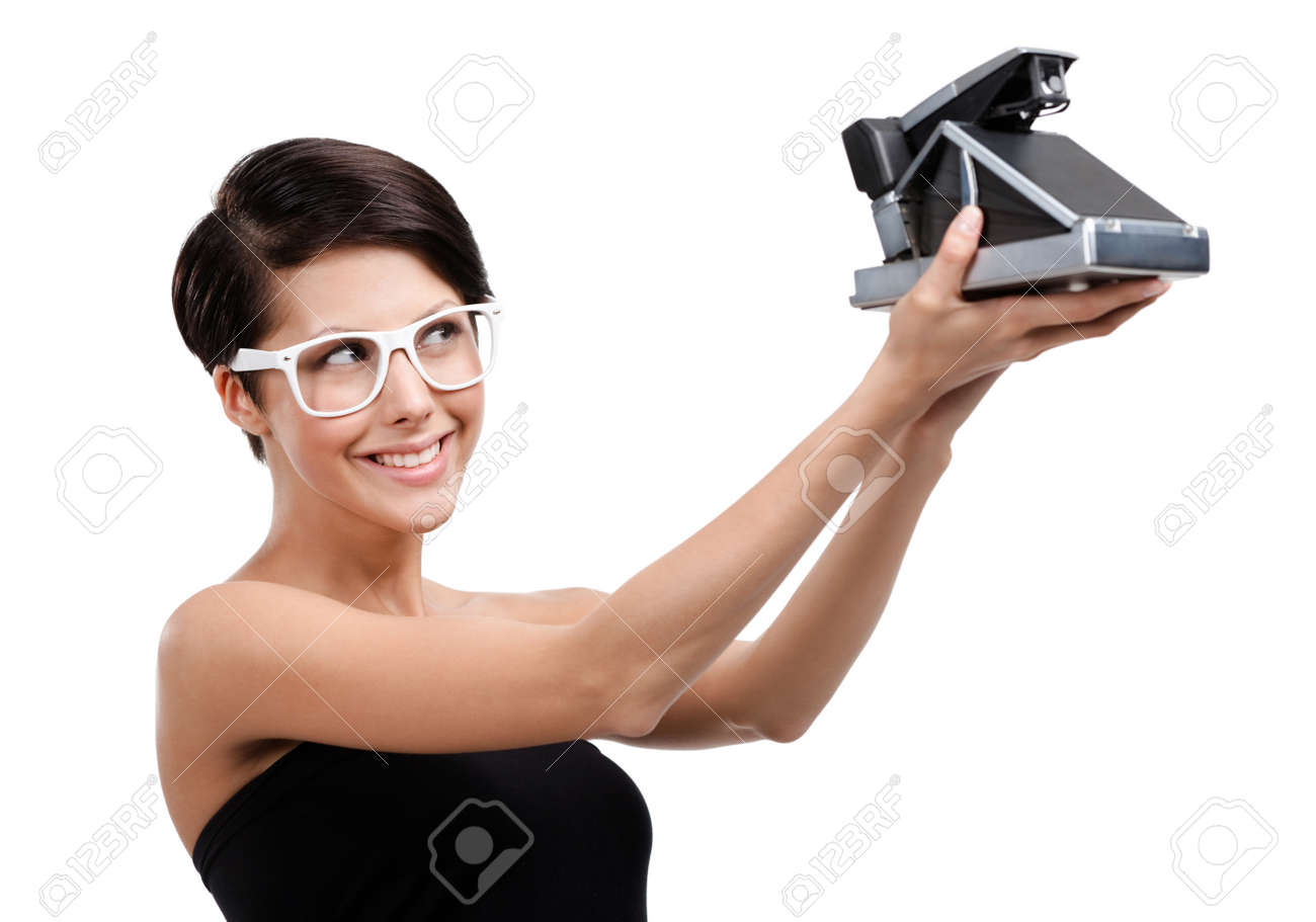Woman takes photos with cassette photographic camera, isolated on white Stock Photo - 15044407