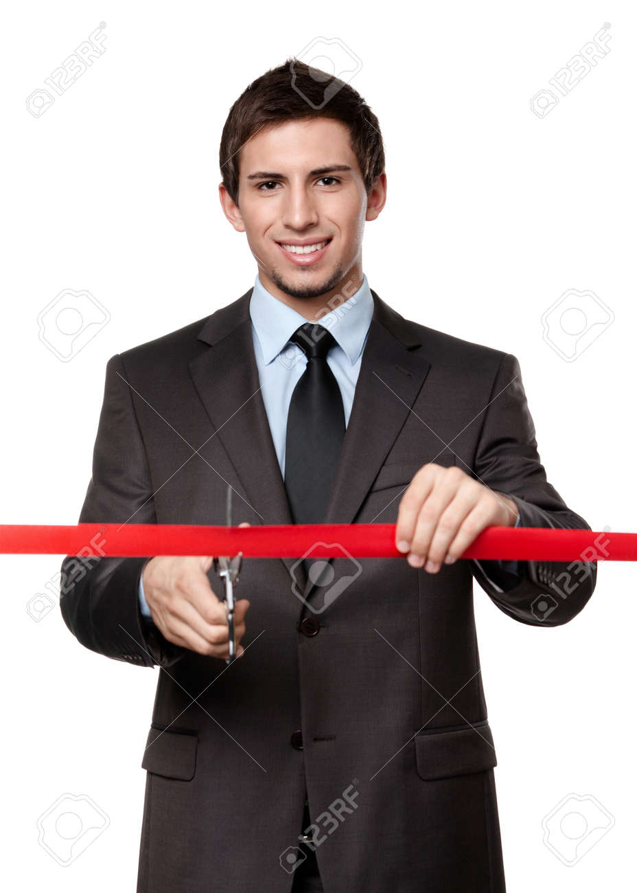 A man cutting a red ribbon with scissors, isolated on white Stock Photo - 15044378