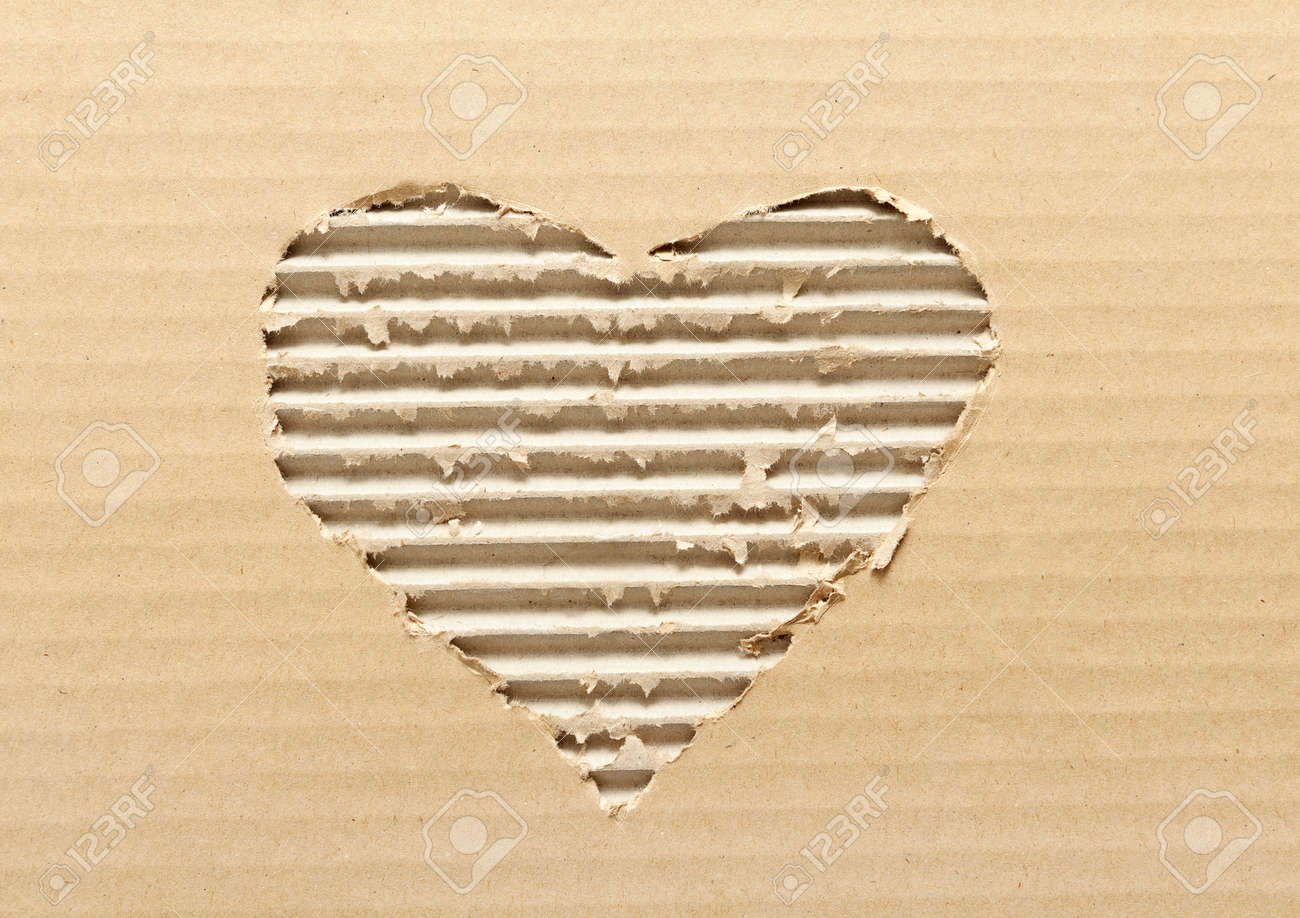Ripped heart shaped corrugated cardboard, brown background Stock Photo - 15498536