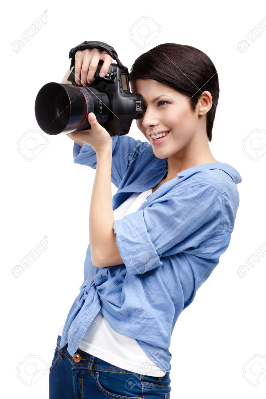 Woman takes images holding photographic camera, isolated on a white Stock Photo - 15177388