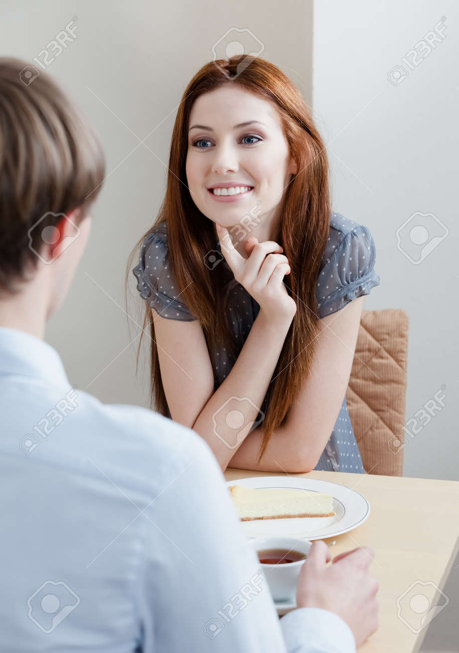 Woman talks with man sitting at the table at the bar Stock Photo - 15433493