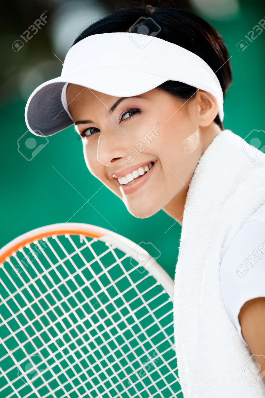 Close up of successful tennis player with towel on her shoulders Stock Photo - 15435373