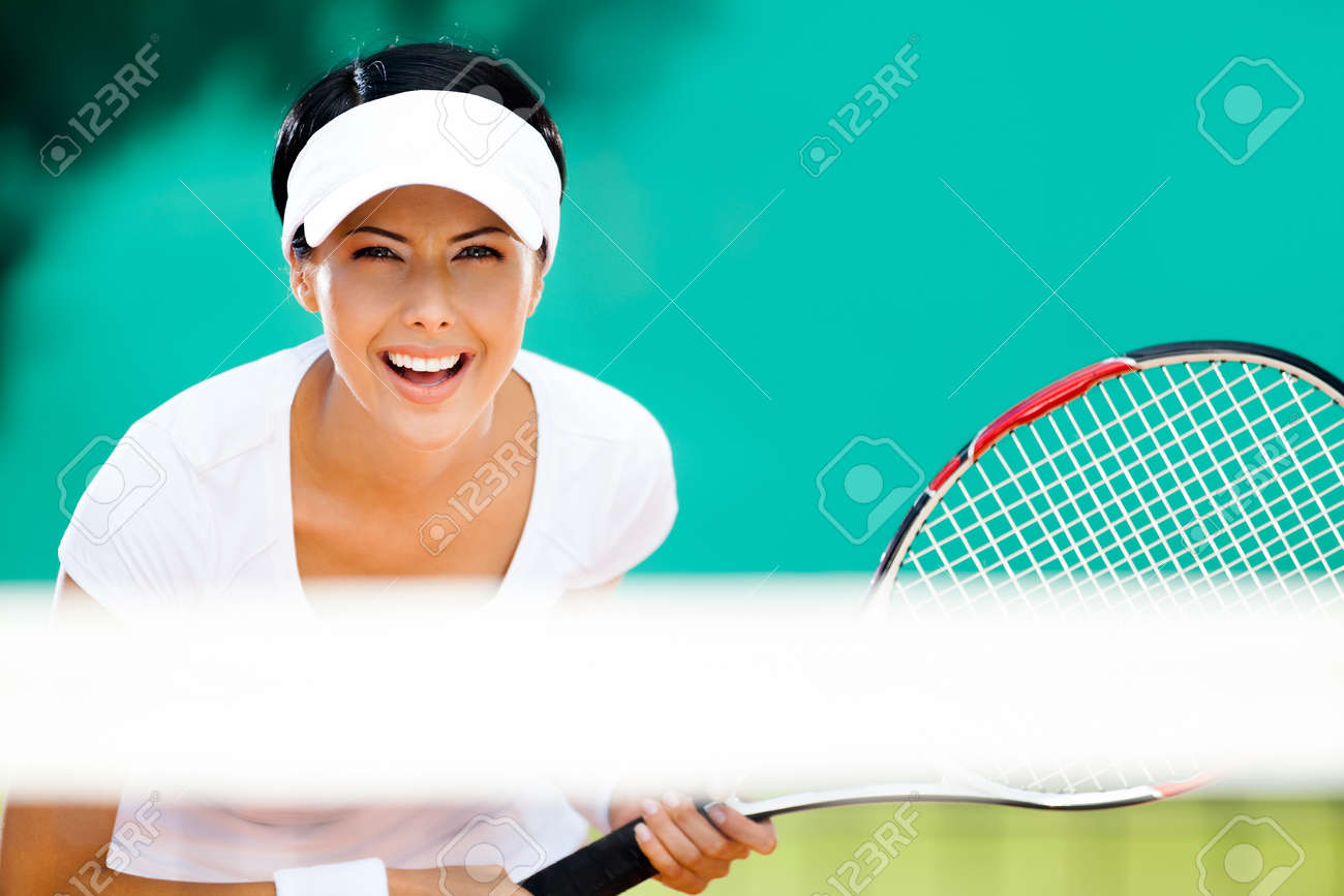 Woman in sportswear playing tennis. Tournament Stock Photo - 15530470