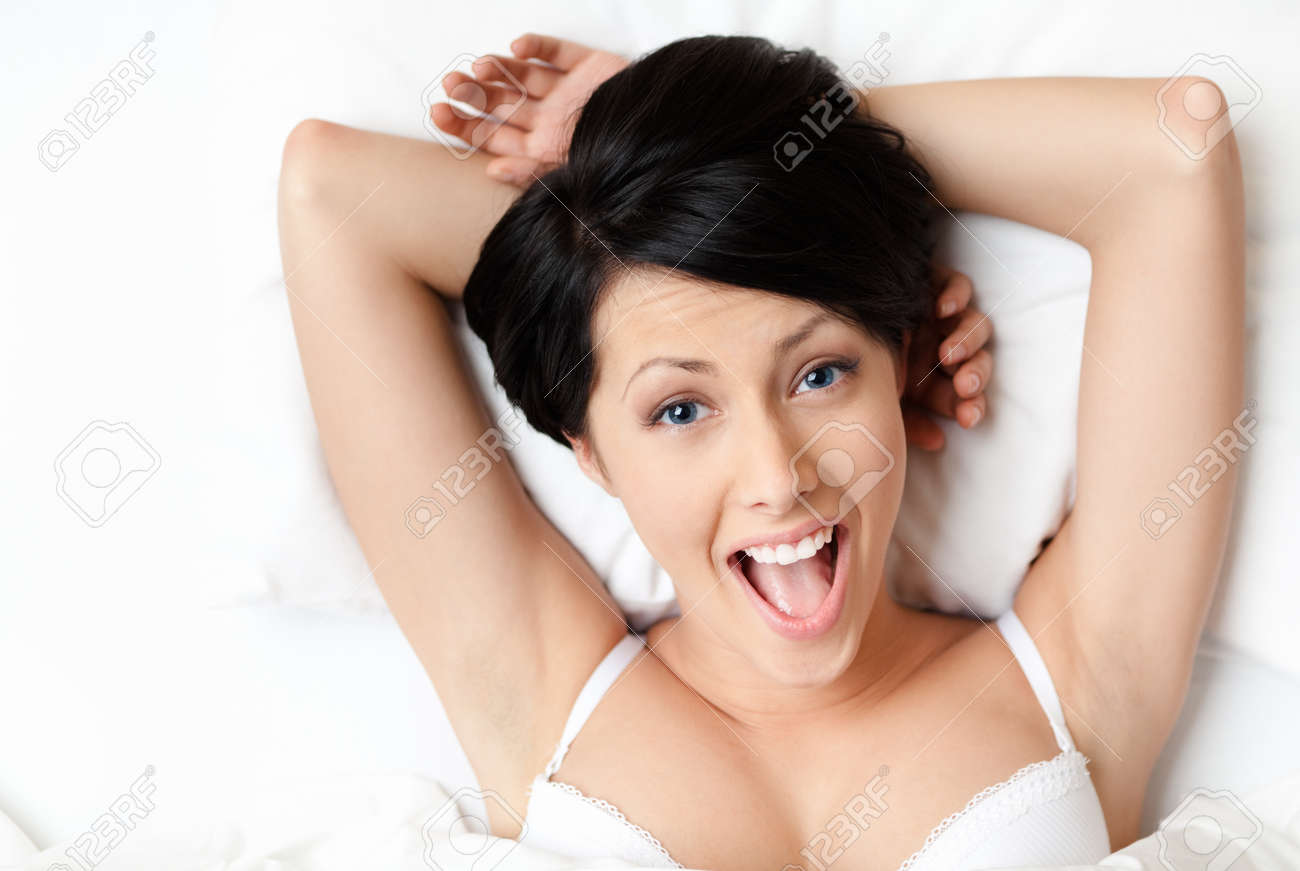 Sleeping sexy woman in the bedstead, white background Stock Photo - 15647294