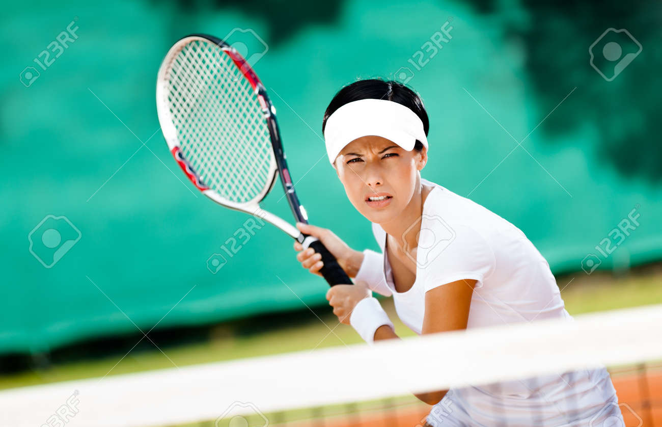 Woman in sportswear playing tennis. Training Stock Photo - 16040626