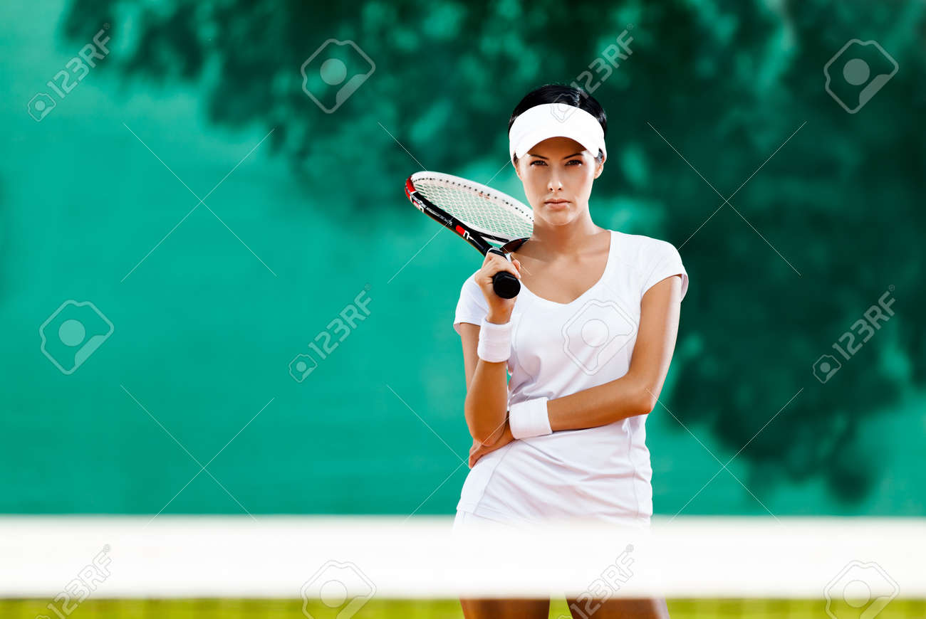 Young sportswoman with racket at the tennis court. Healthy lifestyle Stock Photo - 16243832