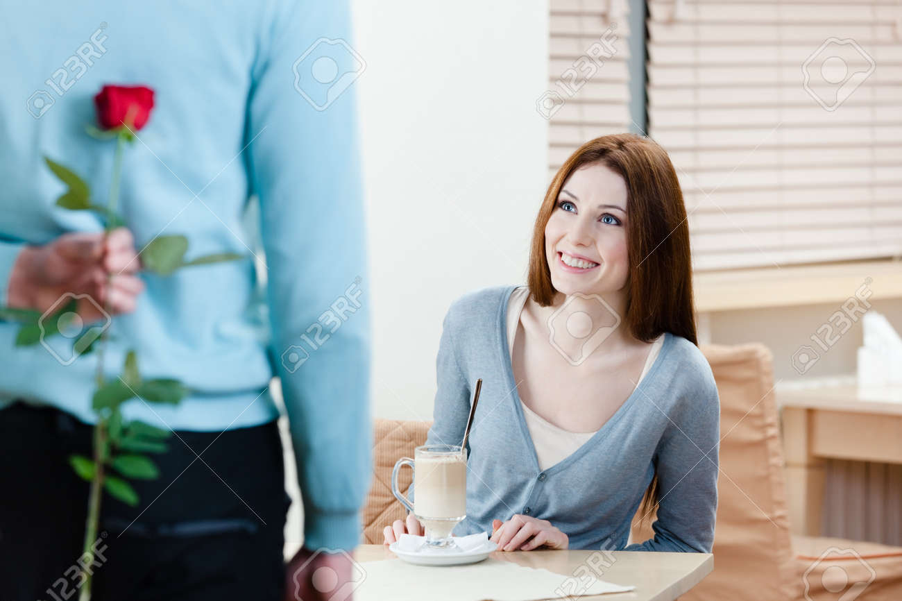 Man keeps scarlet rose behind his back to present it to his girlfriend Stock Photo - 17457753
