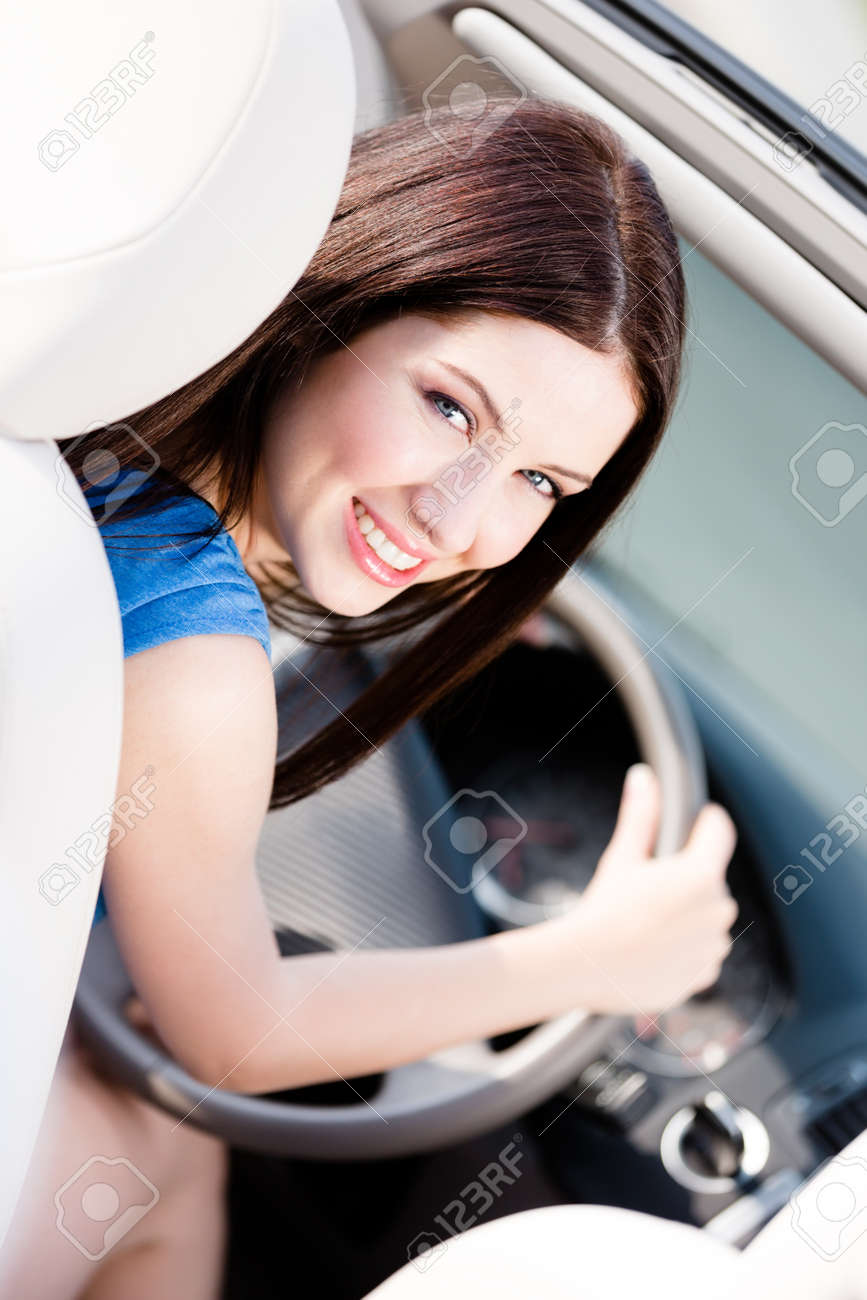 Portrait of young female driver turning back Stock Photo - 17480641