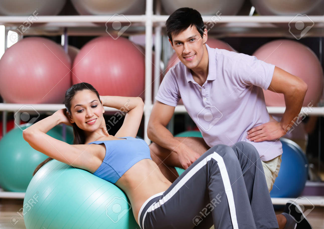 Woman exercises in fitness gym with couch Stock Photo - 17457784