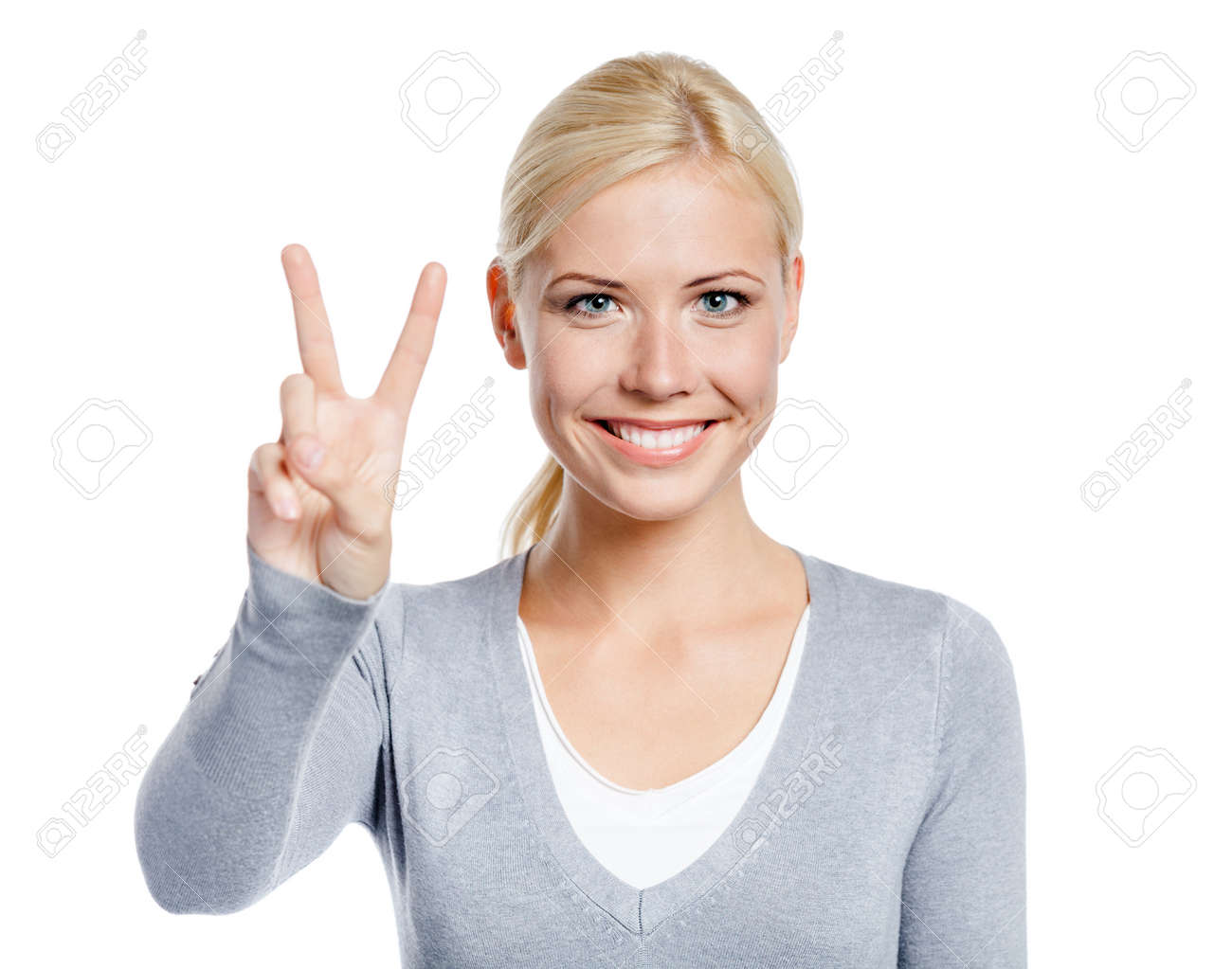 Female peace gesturing with hand, isolated on white Stock Photo - 18915867