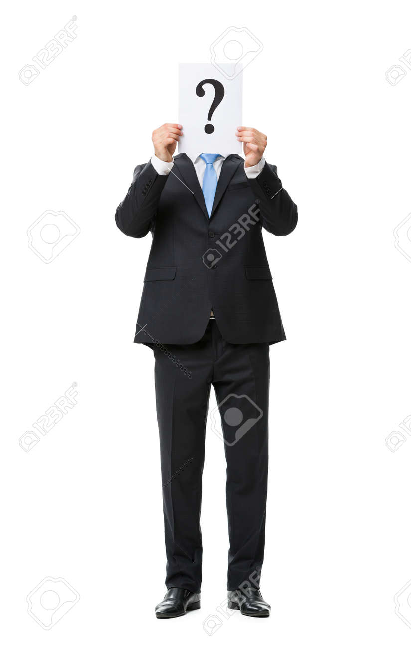 Full-length portrait of businessman keeping question mark in front of his face, isolated on white. Concept of leadership and success Stock Photo - 22279670