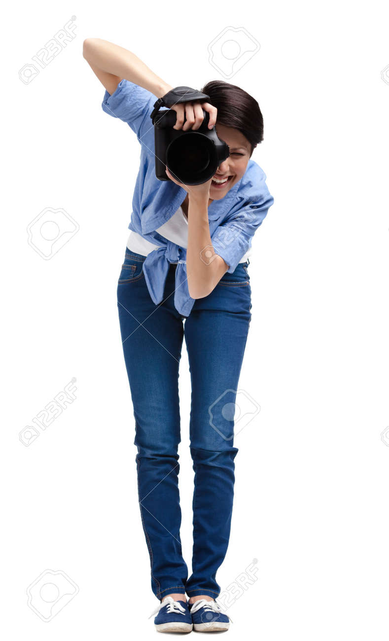 Woman-photographer takes shots, isolated on a white background Stock Photo - 22528170