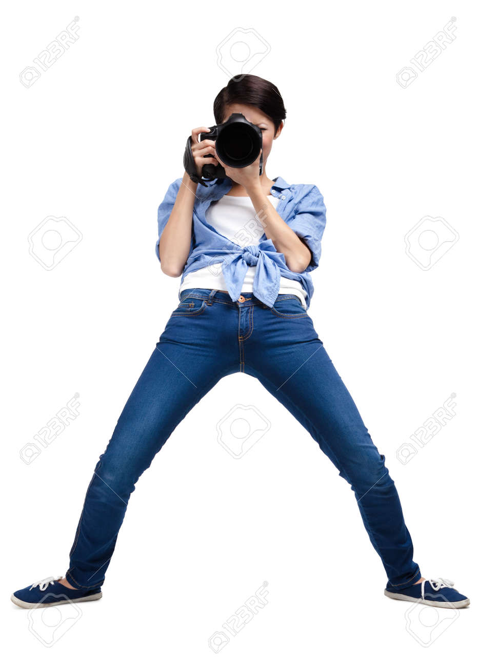 Woman-photographer takes pictures, isolated on white Stock Photo - 22528156