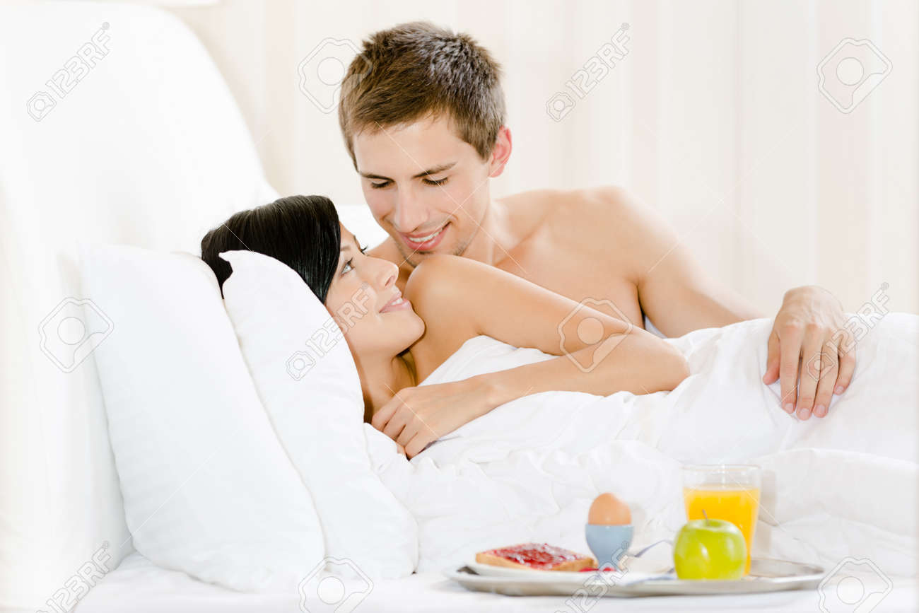 woman and man love man in bed