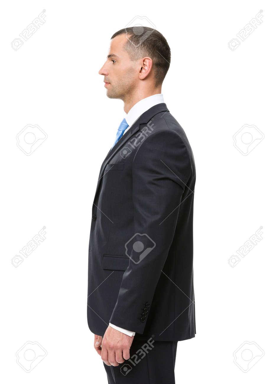 Profil Dhomme Daffaires Portant Un Costume Noir Et Cravate Bleue Isolé Sur Blanc