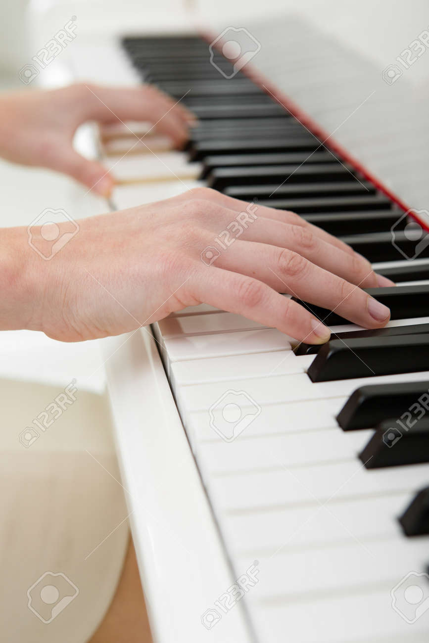 Close up of hands playing piano. Concept of music and leisure Stock Photo - 24480340