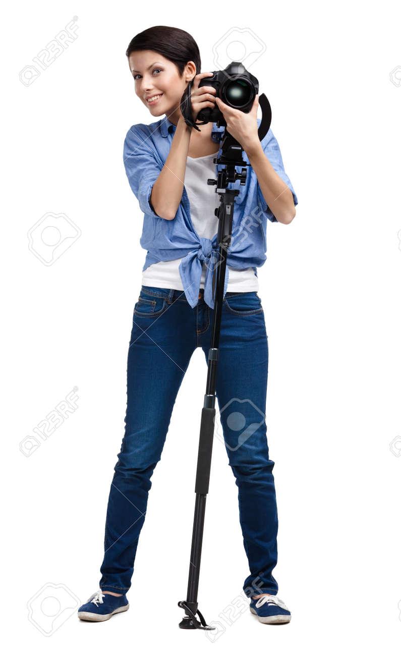 Girl takes shots holding photographic camera, isolated on white Stock Photo - 24480512