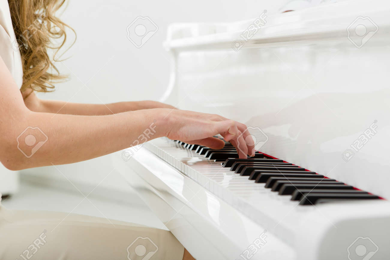 Close up view of hands playing piano. Concept of music and enjoyment Stock Photo - 24481042
