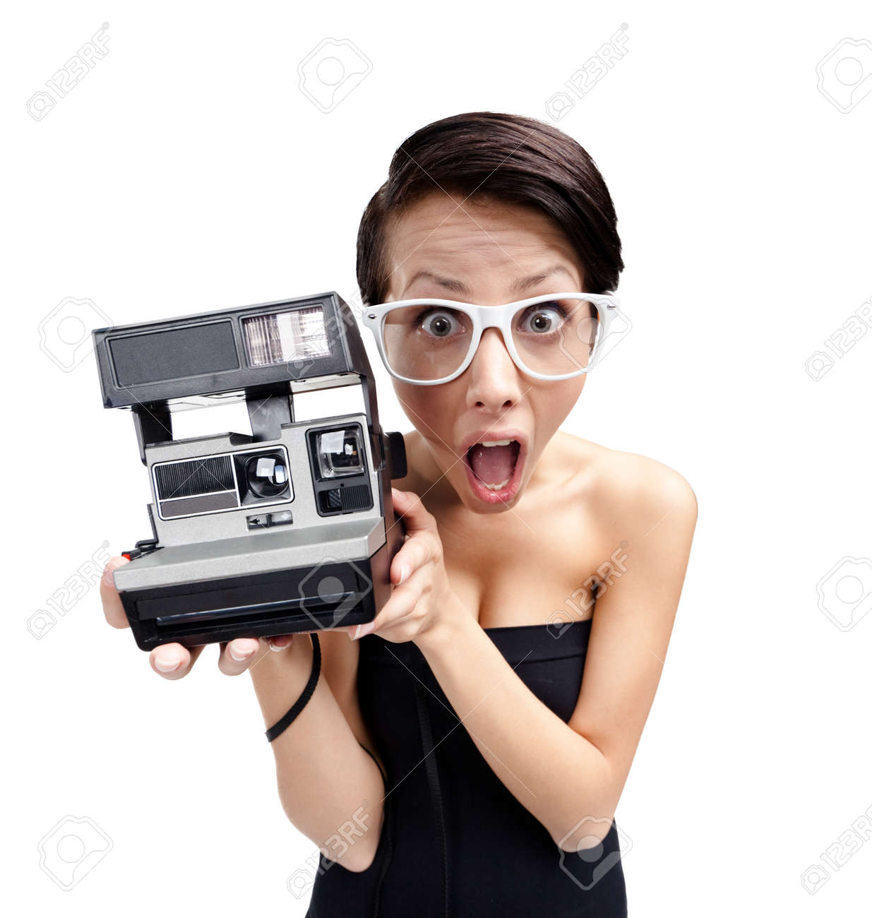 Wondered woman with cassette photographic camera, isolated on white, wide angle Stock Photo - 26692171