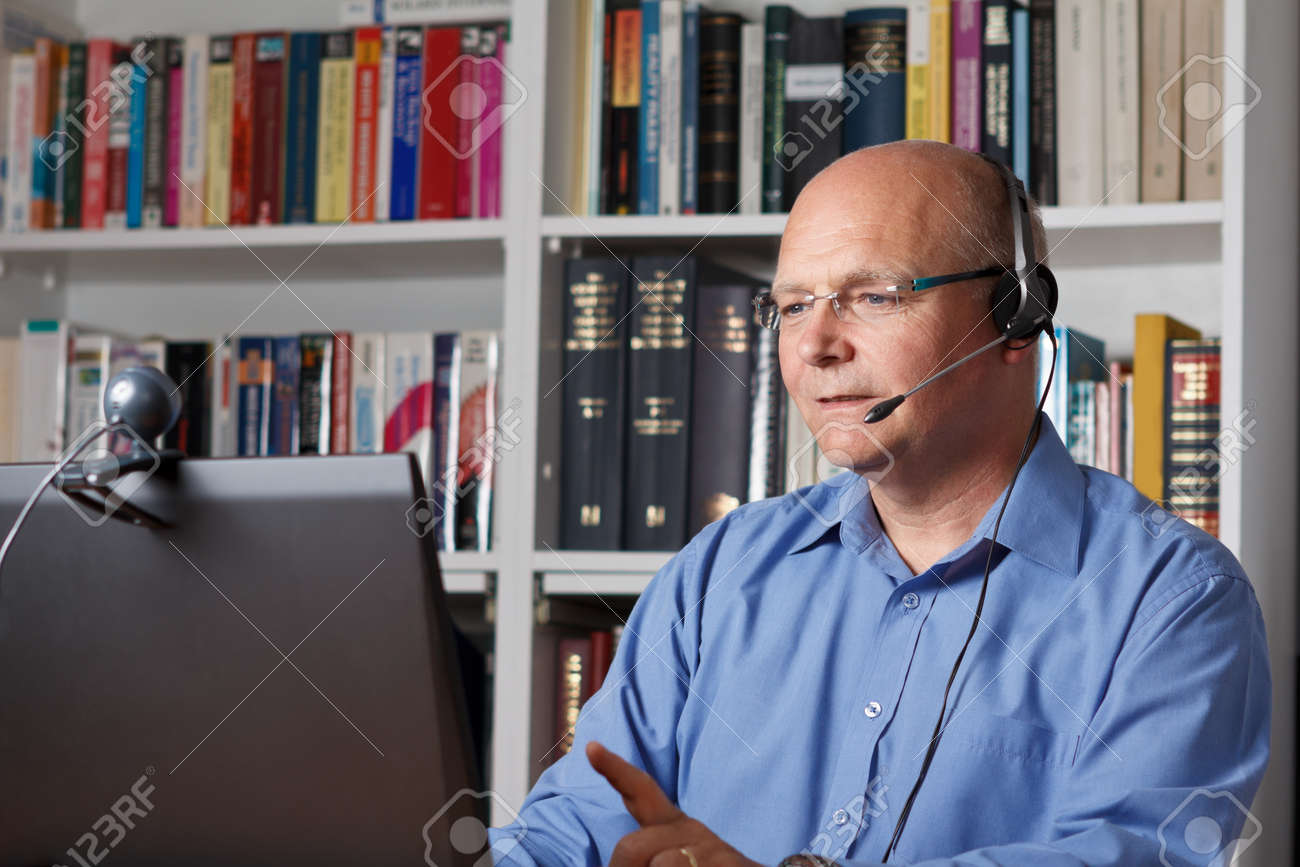 Man telephoning with computer, headset and webcam, copyspace - 25746095