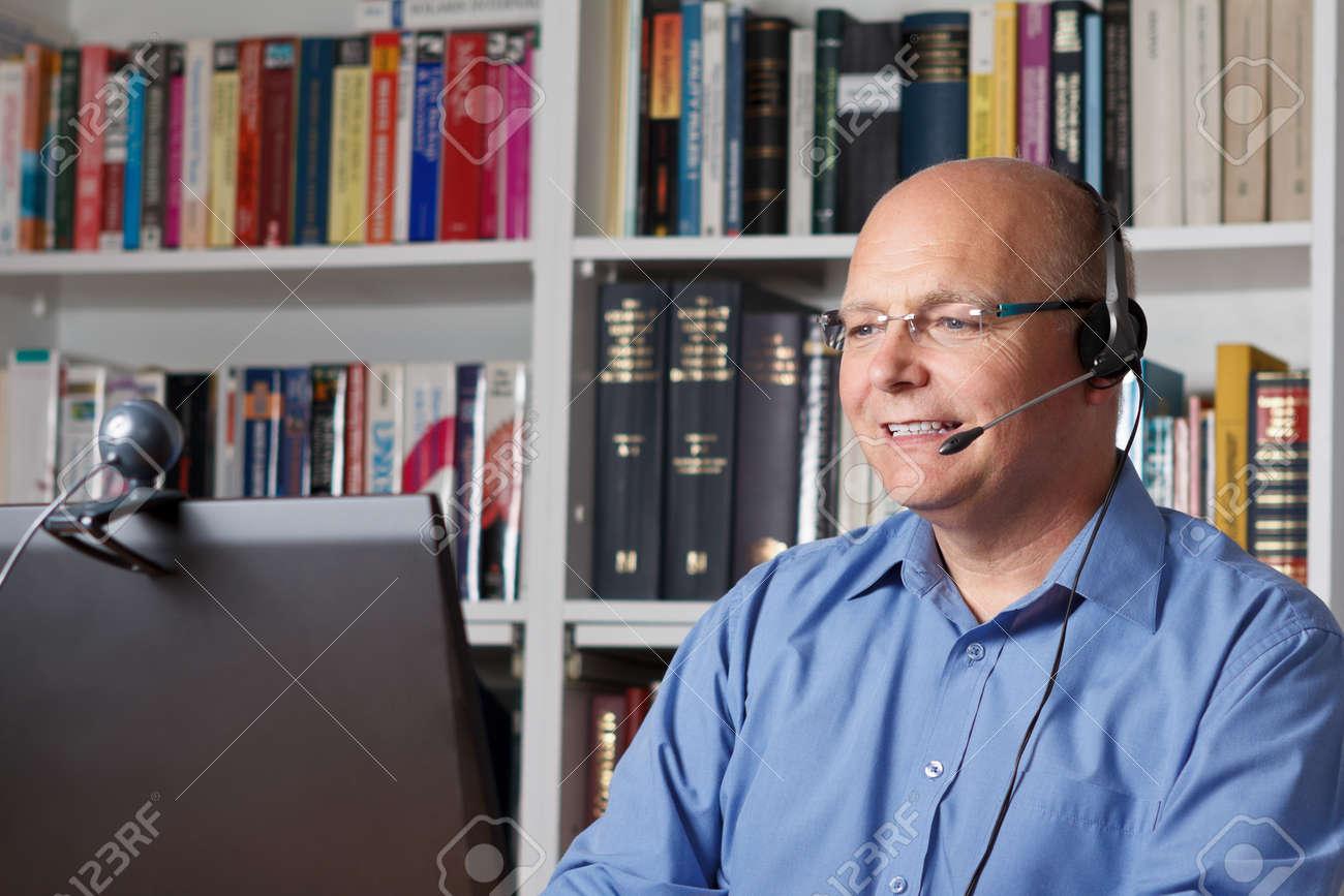Smiling senior man contacting his family via internet, copyspace - 25746245