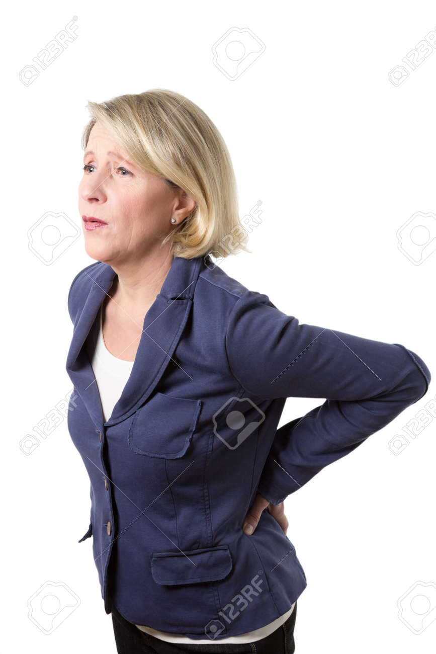Middle aged woman with violent pain because of a lumbago, isolated on white - 25747119