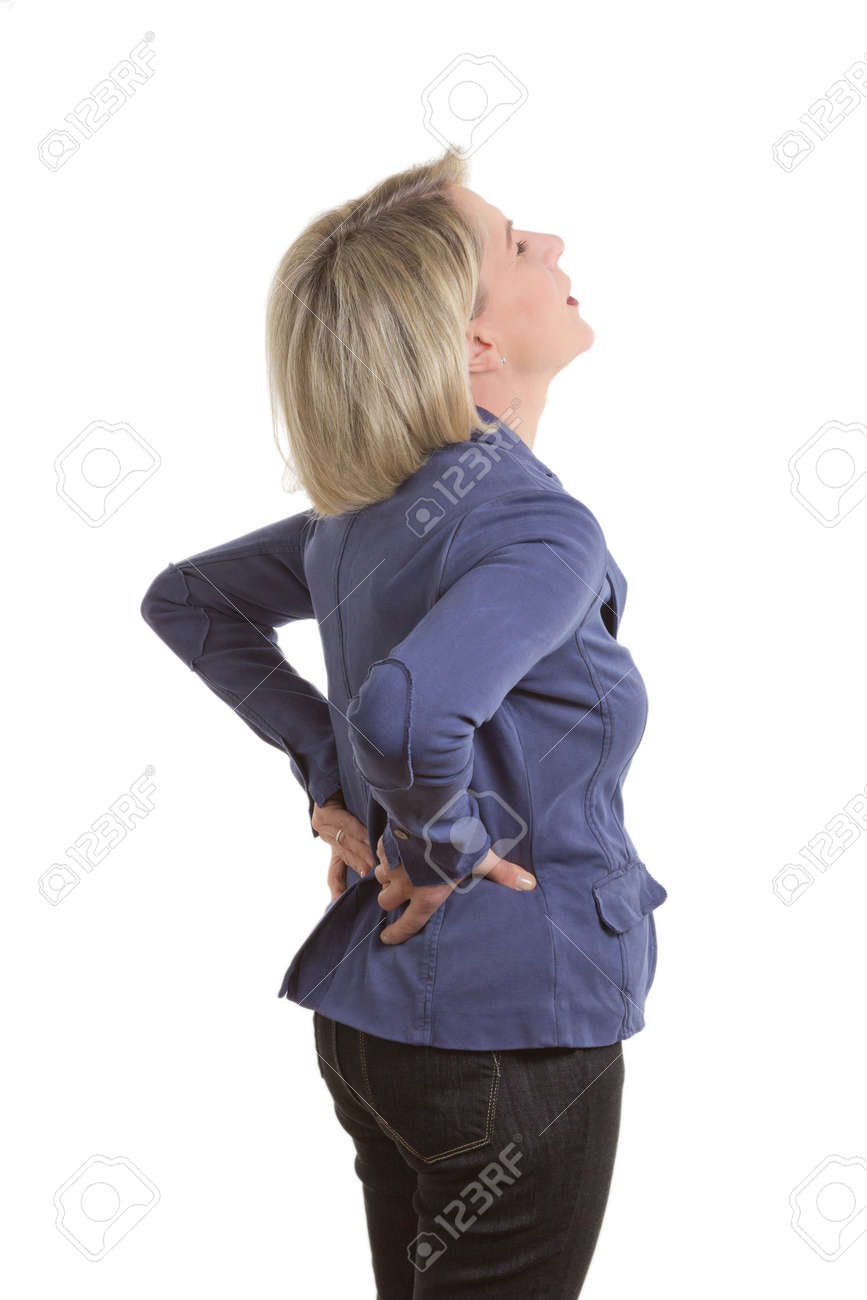 Woman with low back pain because of a pulled muscle, isolated, copy space - 26189173