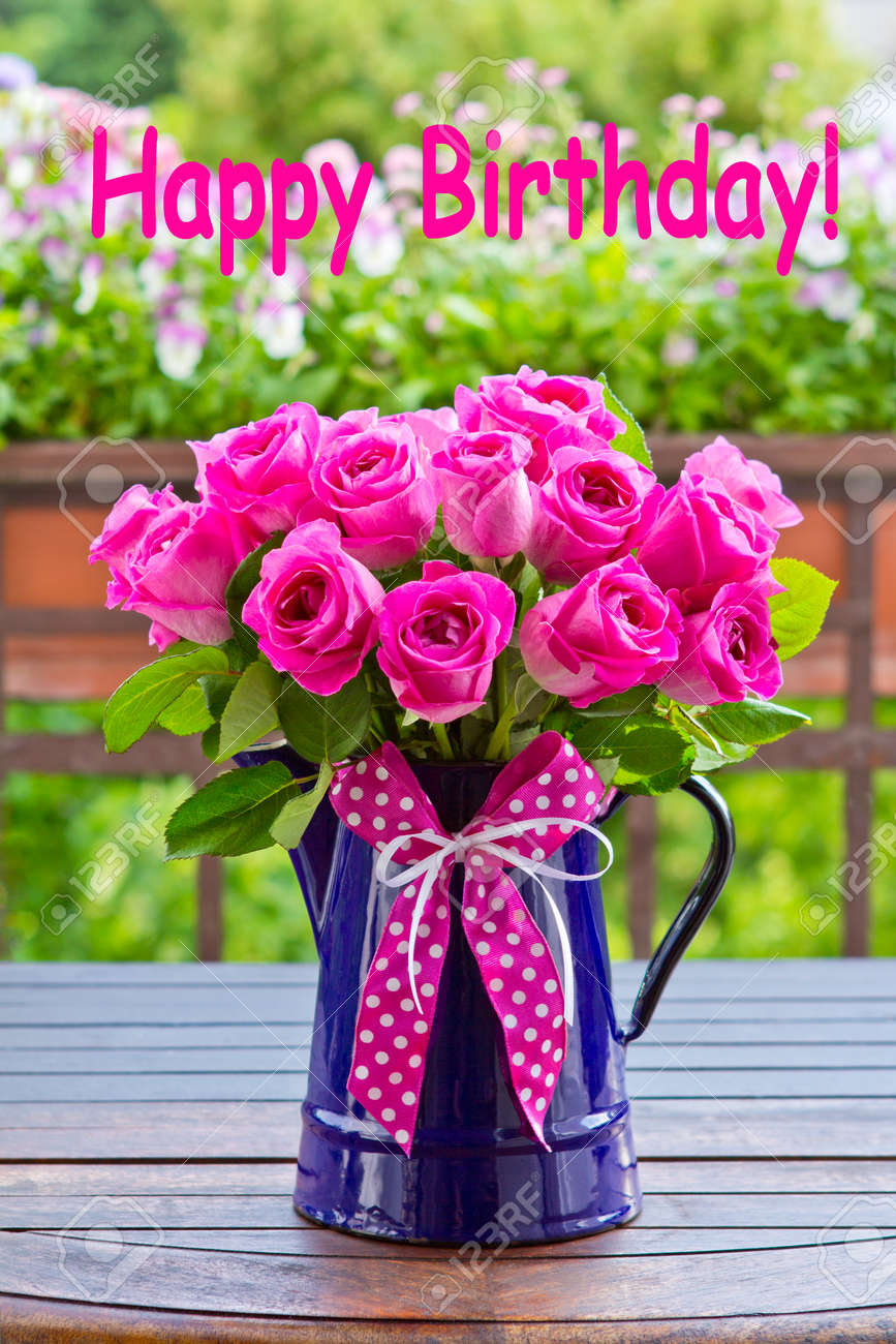 BON MARDI 38215506-Bouquet-of-pink-roses-in-a-blue-enamel-jug-with-a-bow-of-pink--Stock-Photo