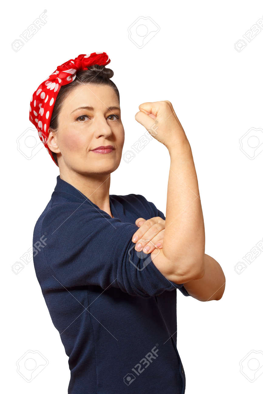 Strong and self-confident woman with a clenched fist rolling up her sleeve, vintage or retro effect of the 40s in America, isolated on white, copyspace - 60220555