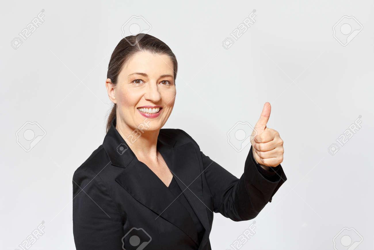 smiling mature businesswoman, professor, advocate or attorney