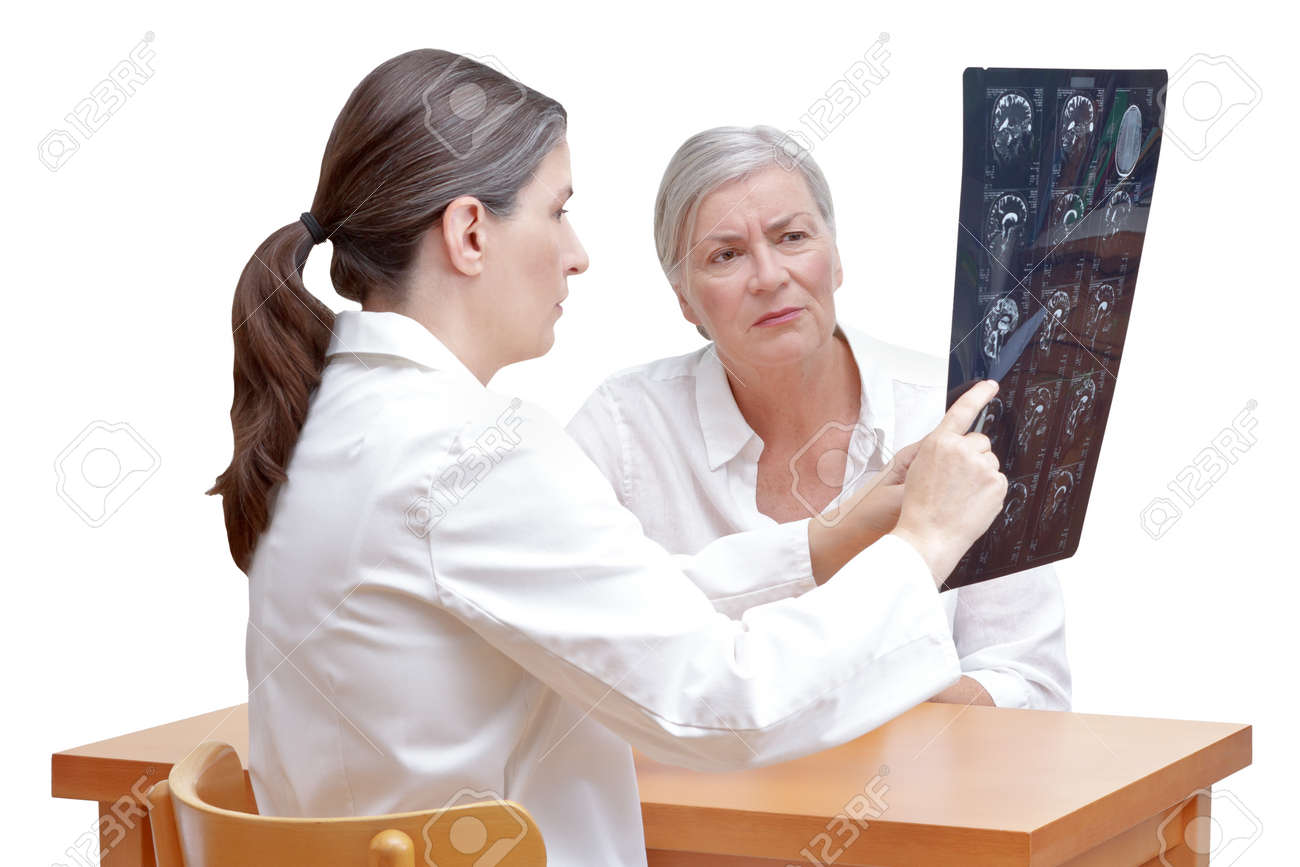 Female middle aged doctor showing her senior patient an mri of her head, isolated on white background - 86492951