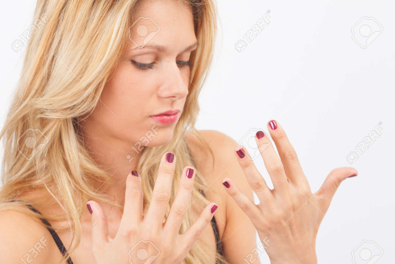 Young Woman Drying Nail Polish On Her Nails Stock Photo, Picture And ...