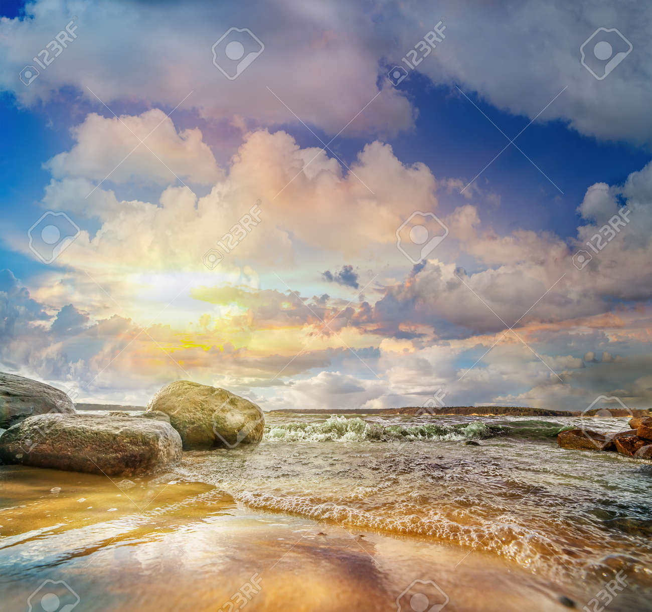 Colorful panoramic landscape with stones and waves at the lake shore on sunset. Lithuania. Kauno marios. - 144922860